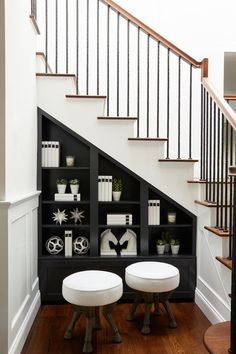 Black built in shelves under a staircase with wrought iron spindles and hoof ste. Black built in shelves under a staircase with wrought iron spindles and hoof steps. Black Stairs, White Staircase, Iron Staircase, Iron Stair Railing, Staircase Railings, Modern Staircase, Staircase Design, Staircase Decoration, Stair Decor