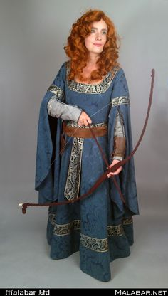 Hollis' version of Princess Merida's look is a beautiful green medieval dress and brown pouch belt