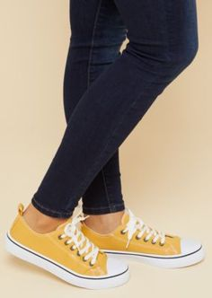 72fb5adb396f Get active in these classic tennis shoes made of a soft yellow canvas and  featuring a
