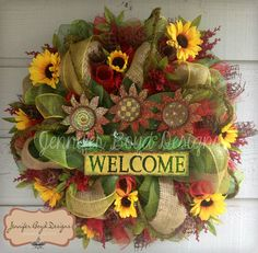 Sunflower Mesh Wreath with Welcome sign, Sunflowers, Moss Garland, burlap, Red and Green. $100.00, via Etsy.