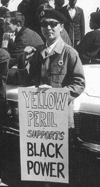 Richard Aoki, who joined the Black Panther Party for Self Defense shortly after its founding in 1966 by his friends and fellow college students Huey Newton and Bobby Seale, displays a Black-Asian unity sign at a 1968 Black Panther rally.  Asian Americans crossed the color line to embrace the ideals of the civil rights movement.