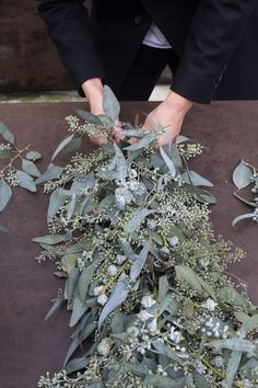 Lovely grey/ blue combination, in this case for a table garland.  Seeded Eucalyptus Blue Gum Eucalyptus, 'Silver Bells' Eucalyptus Pods, Paperwhites (a type of Narcissus), or alternatively or cyclamens,  and Tillandsia / air plants.  Arrangement by Nanette Wong.