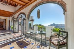 Beautiful arched windows and wooden ceiling, overlooking Mijas in Spain.