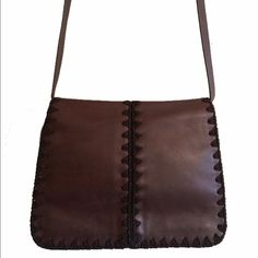 Ellen Tracy Leather Crossbody Soft brown leather with front magnetic flap closure. Embroidered trim. One interior zipper pocket. This is a design by Linda Allard and Ellen Tracy. 8 inches tall 10 inches long 5 inches wide. No trades. Generous discount with bundle. Ellen Tracy Bags Crossbody Bags