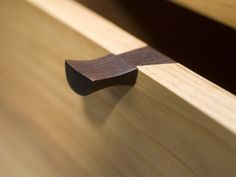 Drawer pull #detail A hole can be drilled into the handle and drawer, a small wooden peg is inserted into a diagonally drilled hole to keep handle from sliding in any direction.