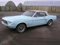 Here it is 1967, powder blue, convertible, can't see the interior- hope it's white leather!