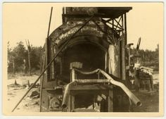 Close-up view of a cremation oven after the destruction and liberation of Bergen-Belsen.  The original caption states, Cremator, where they burned the people who were sick. They burned them alive in here. Notice the bars on which the steel stretcher goes on.