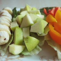 healthy morning plate with banana, apple, carrots, bell pepper and lettuce