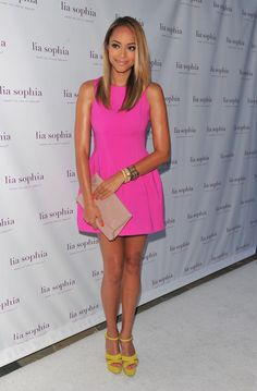 Amber Stevens Platform Sandals Amber Stevens got colorful for the Lia Sophia launch in a full bubblegum pink dress and canary yellow platform sandals.  Amber Stevens Cocktail Dress Amber Stevens was right on trend in a hot pink fit-and-flare cocktail dress with chartreuse platform pumps.