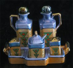 This Lovely 8 pc Art Deco Cruet Set includes: 4 in Oil and Vinegar Cruets, tops are not original, Marbles rather nicely match the set's Rare Martini Pattern Salt and Pepper Shakers Condiment Jar with Spoon and Lid 7 x 5 in Service Tray. Condiment Sets, 1920s Art Deco, Carnival Glass, Old And New, Tea Time, Art Nouveau, Tea Cups, Unique Gifts, Salt