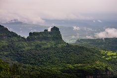 View of the Padargad from Bhimashankar in Maharashtra, India. Bhimashankar, popular for being one of the twelve Jyotirlings, is also a dense and protected forest area. Beautiful Places To Visit, Cool Places To Visit, India Landscape, Virtual Travel, Mountain Landscape, Asia Travel, Trip Planning, Monument Valley, Trek