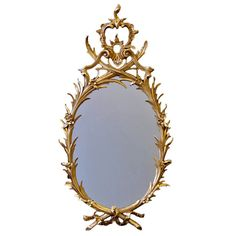 A George III Giltwood Oval Mirror | From a unique collection of antique and modern wall mirrors at https://www.1stdibs.com/furniture/mirrors/wall-mirrors/