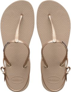 The Freedom Sandal features an adjustable metallic slingback strap for a stylish look and secure fit. The injected, molded sole provides added comfort with our signature textured footbed. Thong style with slingback strap Cushioned footbed with textured rice pattern and rubber flip flop sole Made in Brazil