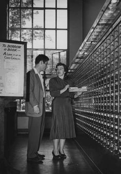 igotsomechildcats:    Librarian showing student how to find a book in the card catalog