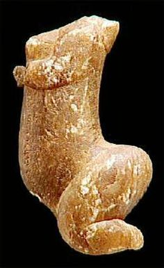 The Venus de Sireuil was collected in 1900 in the Dordogne by M. Prat, on a road to a stone quarry, where a cartwheel which ran over it in the muddy rut where it lay, unfortunately, amputated the head and left hand which were not recovered. The material of the object is of amber calcite, slightly translucent, measuring 92 mm in height. Aurignacian flint was found 150 metres from the statue, in a quarry. It is estimated to be 25 000 years old.