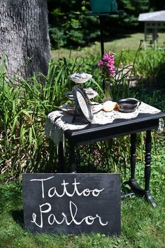Awesome idea!! Mini tattoo parlor on antique side table with pirate, heart and peace sign tattoos. Adorable!