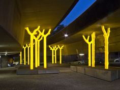 Aspire - Under The Freeway This community-initiated artwork consists of a forest of trees rising up to support the vast freeway overhead. Landscape Elements, Urban Landscape, High Ceiling Lighting, Under Bridge, Street Installation, Sydney City, Bridge Design, Night City, Street Art Graffiti
