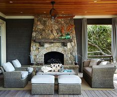 Covered Deck Fireplace: Often reserved for poured patios and porches, a sturdy stone fireplace gives this deck a big style upgrade. A rustic wooden mantel offers display space and helps tie the fireplace in with its surroundings.