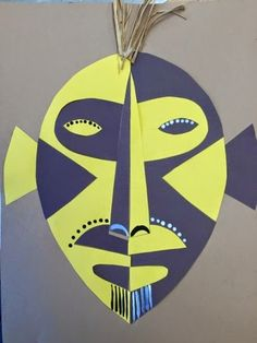 This is a great lesson to combine the topic of African Masks with symmetry. The kids love this project because it is very successful and stunning with the high contrast colored construction paper. African Art For Kids, African Art Projects, Image Pixel Art, Africa Craft, Classe D'art, Afrique Art, 6th Grade Art, School Art Projects, Thinking Day