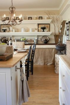 Eat in kitchen with hidden storage under shelving. Like the mix of textures, and neutral background, so colors could easily be mixed