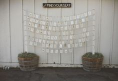poles with twine hanging provide place cards with vintage sign ...