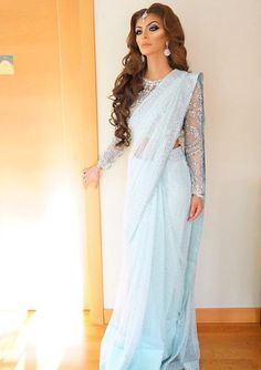 She is sooo beautiful love her light blue sari looks sooo beautiful and amazing on her my favourite.