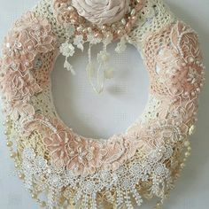 A beautiful elegant shabby chic wreath.Made using a straw wreath, gorgeous vintage doilies and wedding appliques.A beautiful item for any style home or perhaps for your wedding decor.