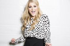 Meghan Trainor poses backstage of the iHeartRadio Village in Las Vegas on Saturday, Sept. 20, 2014.
