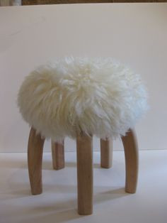 Iconic Patagonia Stool from Argentina; sheep skin cushioned seat, sturdy and sculptural 5 legged lenga wood base.