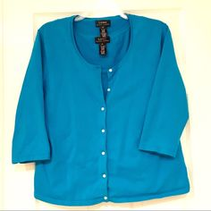 Teal Lauren Ralph Lauren Cardigan Teal button up cardigan with 3/4 length sleeves. 88% cotton 10% nylon 2% Lycra- little bit of stretch to it. EUC. Undershirt shown for layering. Not included. Lauren Ralph Lauren Sweaters Cardigans