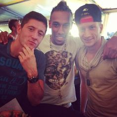 Pierre-Emerick Aubameyang wearing a leopard-print skull T-shirt and rosary beads (and posing with Robert Lewandowski and Marco Reus)