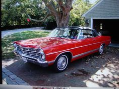 My Dad bought one for us to get to school, but it didn't look half this good! It  had a white convertible top.