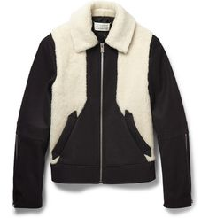 If you're going to invest in one wardrobe item this winter, a warm jacket should be high on the agenda. This black version by Maison Margiela is an astute choice. Made in Italy from soft faux shearling and wool-blend, this contemporary design features a quilted lining and light padding for added insulation. It has a slim cut yet remains relaxed enough to be easily layered over shirts and sweaters.