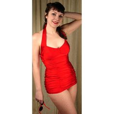 This is a 1950's style halter bathing suit in solid red. It's gathered in 6 places and flattering on any body type. The suit is actually two pieces although it's made to look like a one. The bottoms are cut boy-short style with a full behind for a bit more coverage. The bust of this suit is slightly gathered and ties at the neck and ties. There are no pads in the bust, just lining. $110