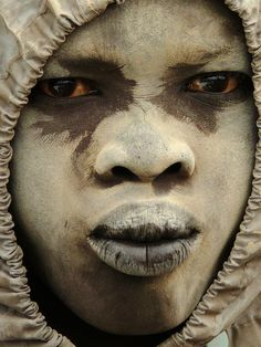 "Africa |  People.  Young Atuot Dinka man outside Yirol.  The ""face paint"" is just ash that the Dinka smear themselves with when in the cattle camps to keep mosquitos and such away."