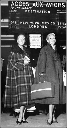 Two of Balmain's models (Geneviève on the left and Lina on right) en route to New York, 1954
