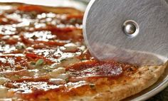 Groupon - $ 18 for Three Groupons, Each Good for $10 Worth of Food and Drink at Pizza Mart ($30 Value)  in Adams Morgan. Groupon deal price: $18