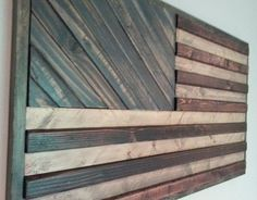 Show your patriotism with this American flag inspired wood wall art. Handmade to order - custom sizes and colors are available! Please send me a message with your requests. As shown, the dimensions are 21x34.5 and colors include Red Mahogany, Weathered Oak (stripes), Vintage Blue (stars patch), and Ebony (frame). Have another wall art pattern in mind? Check my shop for other styles or send me your ideas and I can create a piece just for you.