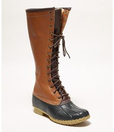 """<p>The iconic L.L.Bean Boot updated in a classic over-the-calf style, lined in premium American shearling– from shaft to sole– for exceptional wintertime warmth. Crafted from genuine full-grain pebbled leather with a """"military shine"""" finish, our 14-eyelet lace-up boot adds modern polish to the rugged look of our original Maine Hunting Shoe®. Handstitched right here in Brunswick, Maine, with the same eye for quality and attention to detail we've built into every ..."""