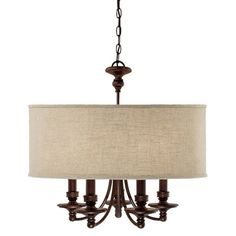 Bronze-finished chandelier with turned detailing and a fabric drum shade.    Product: Chandelier   Construction Materia...