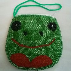 Frog coin purse Brand new beaded coin purse with wristlet. Measures 4 inches by 3.5 inches Bags