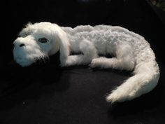 """Well, the amazing folks at Etsy shop GameGuardians decided to make a handmade plush version of Falkor, and he's basically perfect. 