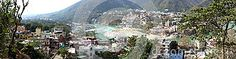A high panorama view from an elevated perspective looking down at Lakshman Jhula Rishikesh and the Ganges River in the foothills of the Himalayas. Rishikesh, Himalayan, Perspective, Tourism, River, Stock Photos, Image, Turismo, Himalayan Cat