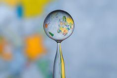 A political map of Earth becomes a globe in a droplet of water.