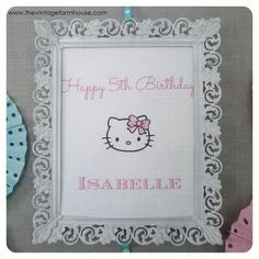 hello kitty birthday party, crafts, mason jars, I spray painted an old frame white added another printable to the center and tacked it to a cork board with blue polka dot ribbon