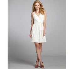 Phoebe Couture white tonal striped sleeveless belted dress
