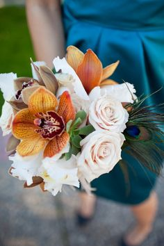 Peacock feathers in exotic bouquet   Dorothy Huynh Photography › weddings