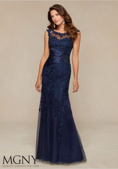 Evening Gowns and Mother of the Bride Dresses by MGNY Beaded Lace Appliqués on Net Trimmed with Satin Matching Stole. Colors: Navy, Silver.