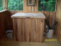 Cover a chest / deep freezer with wood.  Love it.