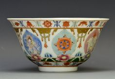 """A Chinese Famille Rose 'Baragon Tumed' Bowl, 19th Century, the bowl finely painted with seven leaf form panels displaying the Buddhist 'Seven Regal Treasures' each leaf supported by a blossom floating on waves encircling the foot, a band around the lip and foot display the """"Eight Auspicious Emblems"""" separated by shou characters of longevity, the base with 'Baragon Tumed' mark in iron red, 5 1/2 in. DIA, 2 7/8 in. H."""